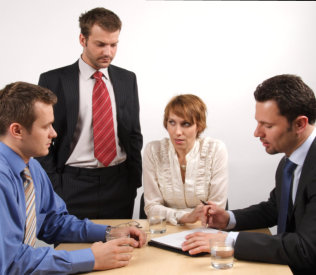four professionals having a meeting