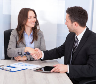 happy female client shaking hands with a professional